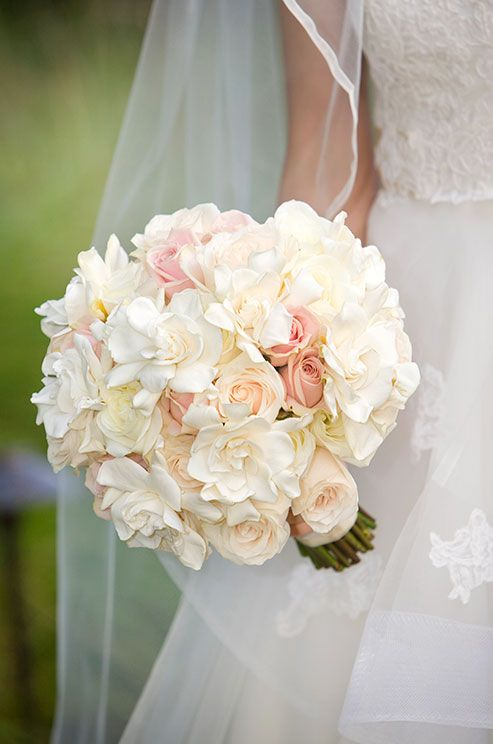 White gardenias and soft pink roses are incredibly romantic for a bridal bouquet.