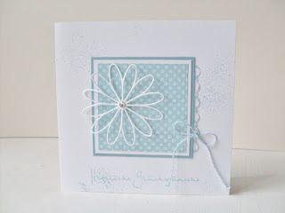 Delicate design, soft colours, offset flower.