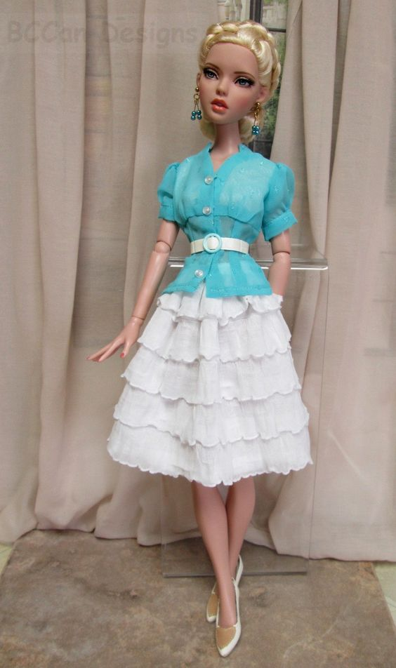 https://flic.kr/p/2g35msh | Pennelope in ruffles 003 | Great blouse by Boulevard Fashions along with one of my ruffled skirts.  Hair has also been restyled.  She has since changed her image again seeing as this pic is five years old.