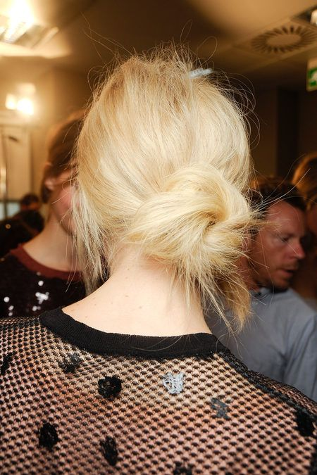 "Bottega Veneta. Messy middle part gathered into a low off center ponytail. Tie a loose rope braid and wrap it into a bun. Tug it a little to create more ""mess"""