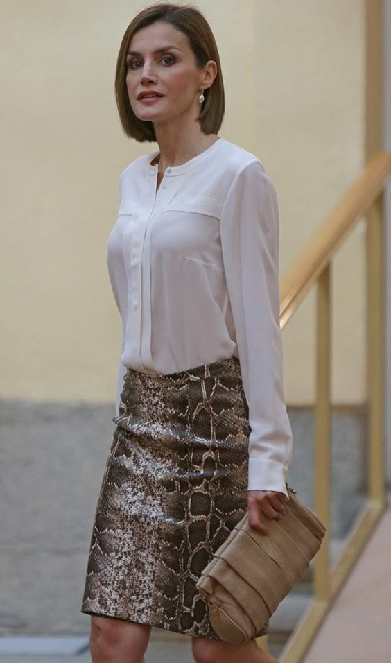 This is a really cute skirt. I wouldn't style it with that blouse though as classic as it is. I think this outfit could use a pop of color on top that is fun but doesn't look garish. Or even black would've been a better option.