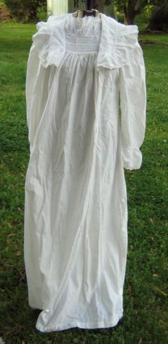 """This Went iN my Wardrobe...VINTAGE ANTIQUE VICTORIAN LADIES COTTON NIGHT GOWN CUT WORK  EMBROIDERED TRIM. A vintage antique Victorian ladies white nightgown. White cotton, great trim and white embroidery decoration on the bodice and on the huge shawl collar. Appears to be machine sewn. Long sleeves have flared cuffs with the same trim.  In wonderful condition.No damage  Cotton is sturdy.  Musty from storage. 55""""L... Laying flat 20 in. across laying under t arm pits. Sleeves measure 25 in.L.."""