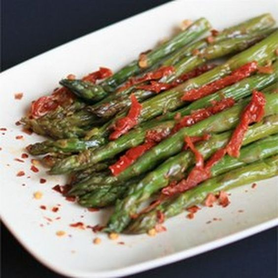 Sun-Dried Tomato Asparagus Recipe Side Dishes with olive oil, garlic, sun-dried tomatoes, fresh asparagus, beef broth, salt, pepper