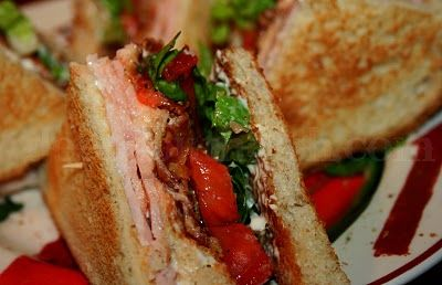 Cajun Club - A classic turkey club sandwich with garden deli turkey, crisp bacon, garden fresh tomatoes, romaine lettuce and finished with a spicy Cajun mayonnaise.