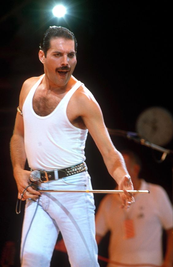 FREDDIE MERCURY  -  On 24 November 1991, Mercury died at the age of 45 at his home in Kensington.  The official cause of death was bronchial pneumonia resulting from AIDS.  The funeral service was for 35 of his close friends and family, with the remaining members of Queen and Elton John among those in attendance.  His ashes were buried in an undisclosed location.