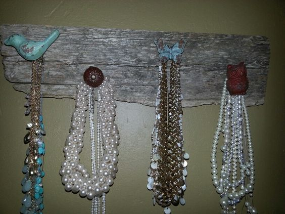 I made this with old barn wood and knobs from craft store.