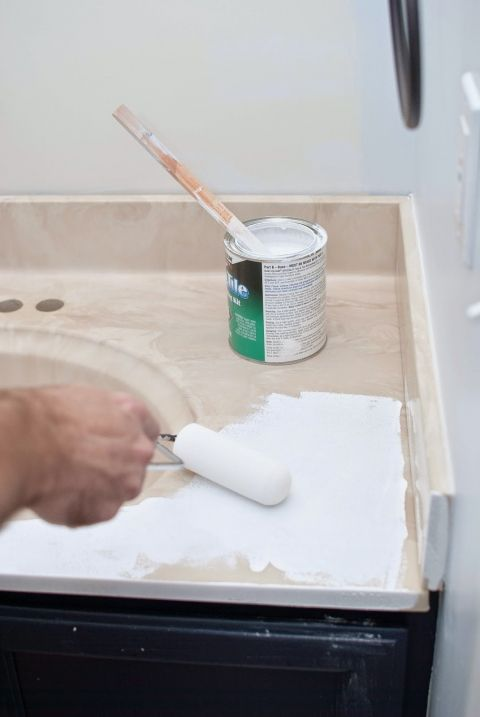painted bathroom sink and countertop DIY - I'm Flying South featured on @Remodelaholic