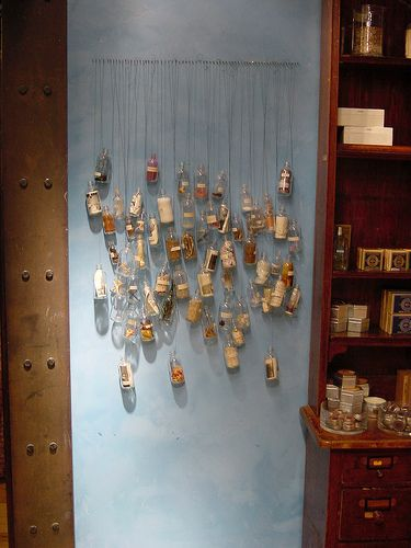 This is a cool way to display a sand collection diy for Glass bottle display ideas