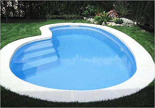 With this kidney bean shaped pool you get just enough space to swim around a little and relax, plus the steps are built right in. No need for anything extra if you don't want it.