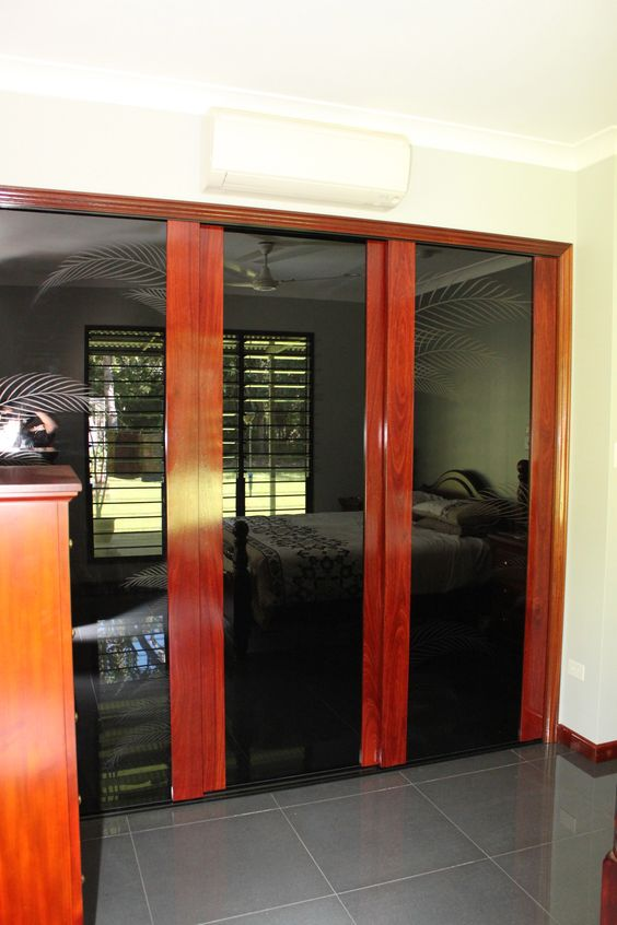 Infinity Sliding Doors with Jarrah Timber, black glass with Palm Throng Motif. The hi gloss finish was essential to match the tiles and existing furniture. https://www.formfunctionnt.com.au/