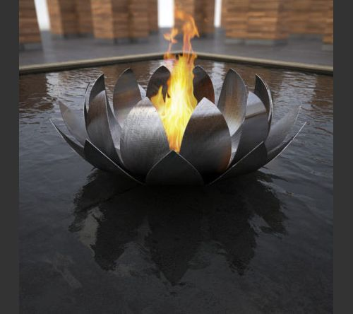 Lotus Bowl fireplace, which is a flower-inspired fire pit with rolled stainless steel petals encircling the flame