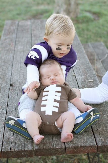 Adorable Halloween costumes: Big Brother is a football player, baby brother is the football. CUTE!