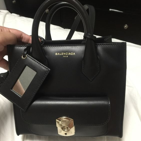 Balenciaga mini padlock Price drop!!!! For sale. percent authentic. Very good condition. Black balenciaga mini padlock. Crossbody bag. Price negotiable thru pal! Email me kayehayag@gmail.com for serious inquiries only please Balenciaga Bags