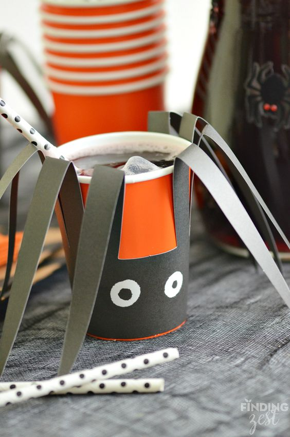 Serve up this easy black spider party punch for Halloween in dressed up cups and pitchers to continue the spider theme!