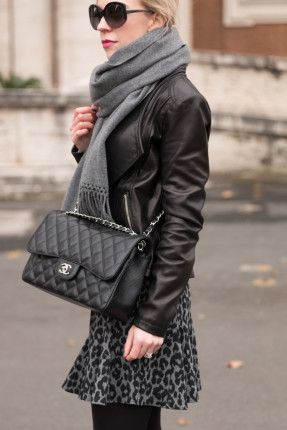 Chanel Jumbo classic flap bag black caviar with silver hardware, black leather moto jacket with oversized gray scarf and skirt winter oufit, how to layer with a leather jacket