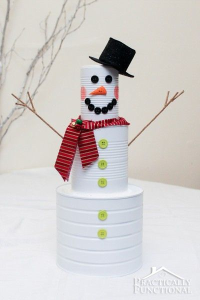 This tin can snowman is a great way to recycle some leftover tin cans to create an adorable DIY Christmas snowman