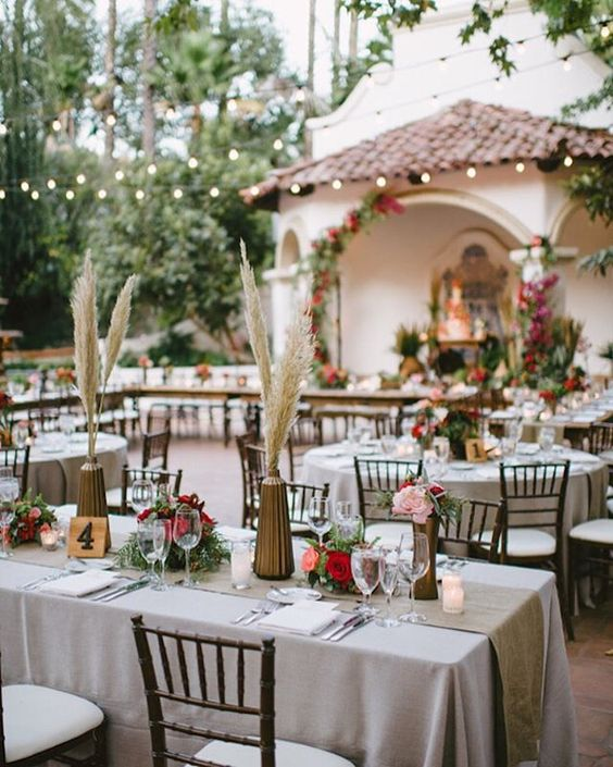 How cool is this outdoor ceremony set up?  The festoon lights, the bright hues and the mixed height centrepieces. As spotted in our pampas grass round-up earlier this week.  Photo by @SargeantPhoto via @stylemepretty // Design by @lvlweddings  #wedding #inspiration #decor #stylish #chic #pampasgrass #uniqueideas #uniquewedding #bmloves #bridalmusings