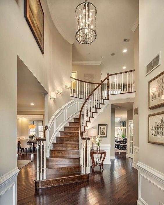 Warm and welcoming foyer luxury entryway modern for House plans with stairs in foyer