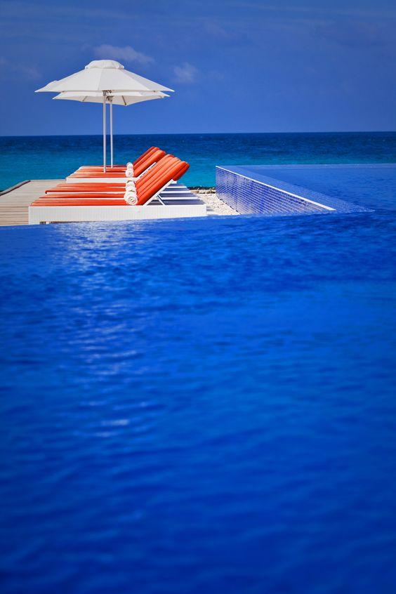 The pool of Conrad Maldives Rangali Resort Island