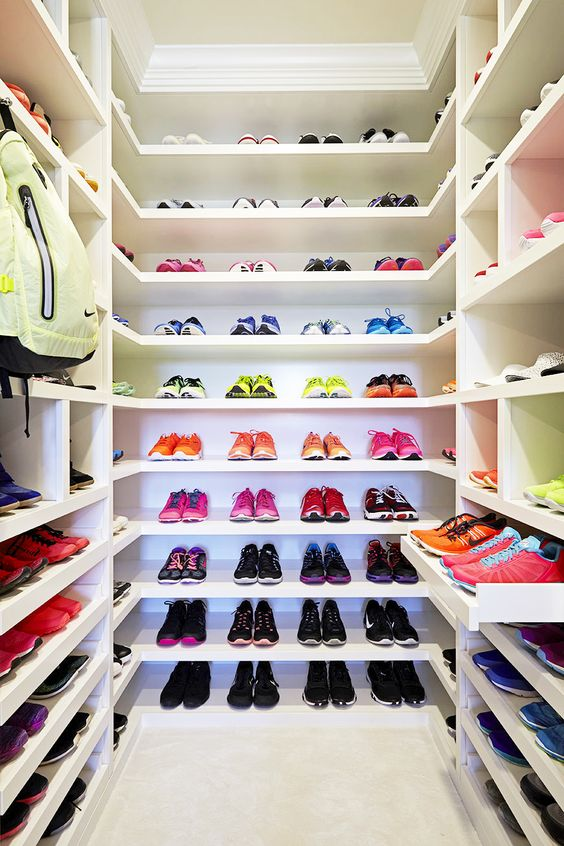 White shelves full athletic shoes in every color