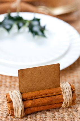 Cinnamon sticks wrapped with twine -- place holder card:
