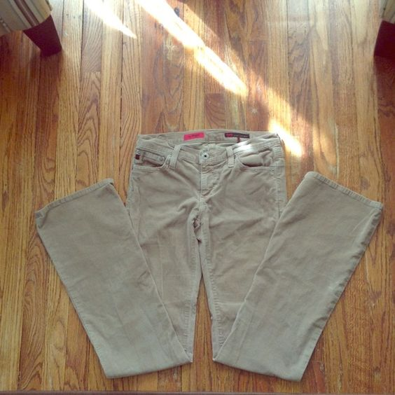 """AG """"the Angel"""" khaki color corduroy jeans size 27R Size 27R. 31 inch inseam. Boot cut with 8 inch wide bottom (16 inches around). Zipper and button closure. Two front pockets and two back pockets. Back pockets have signature """"A"""" stitched on them. Worn, but washed and in excellent condition! 98% supima cotton and 2% elasthane for a hint of stretch. Feel free to ask me any questions AG Adriano Goldschmied Jeans Boot Cut"""