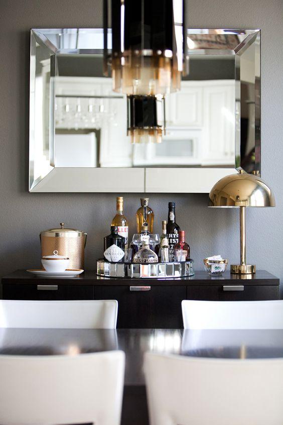 dining room, mirror, bar, brass mushroom lamp, 1970's Italian ice bucket, white chairs, West Elm horn pendant lamp