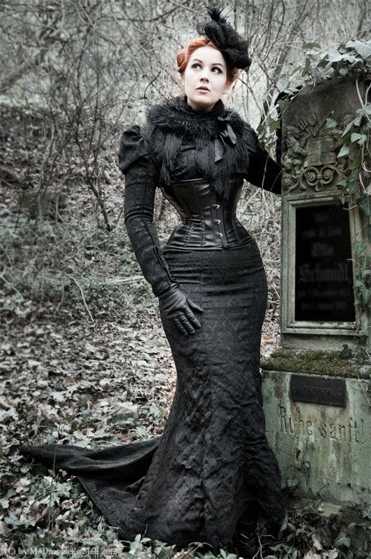 Gothic victorian-inspired trained fishtail gown, fur wrap,  vinyl/leather/pvc underbust corset. Original source lost in a succession of  lazy, ungra
