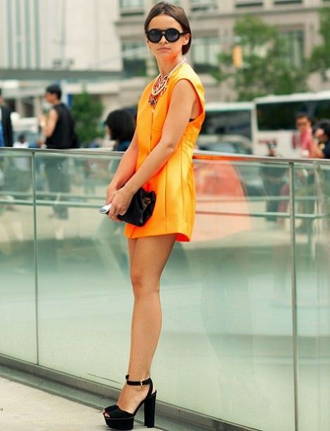 I love this orange one piece it's so pretty and simple and the black evens out the look but it doesn't look overpowering. It's very girly and I can imagine myself wearing this to a fashion show maybe as a buyer.