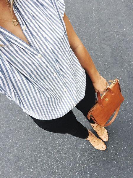 Circle necklace, stripes, black pants