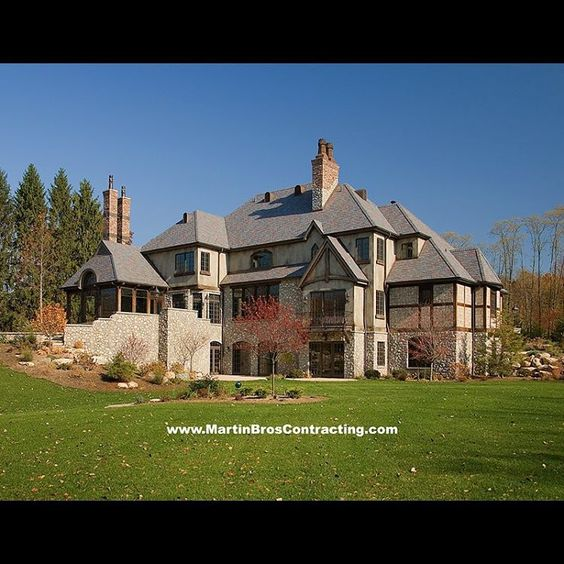 Our September 2016 #calendar selection is this beautiful #Michigan #estate. The amazing 14,146 sq. ft. #French country home full of rough sawn timber and stone is a perfect fit for the property on which it sits. #Handcrafted by #Michiana's finest #artisans this #customhome is one-of-a-kind! #Kolbe Windows #ColonialBrick #MohawkClinkers #stone masonry #stucco #MartinBrothers #thefinesthomesanywhere #contractorsofinsta
