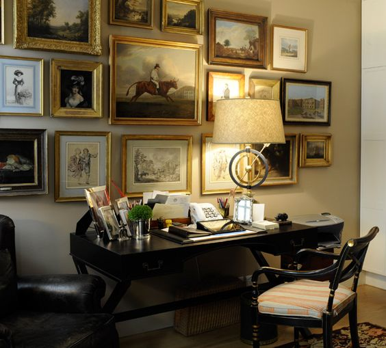 A Collection of beautiful small painting shown over desk. designerNicholas Haslam. Working desk.