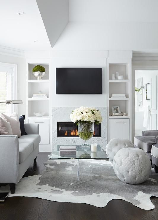 White And Gray Modern Living Room Boasts A Dove Gray Sofa Topped With Pink And Black Pillows An Living Room Grey Modern Grey Living Room Living Room Decor Gray