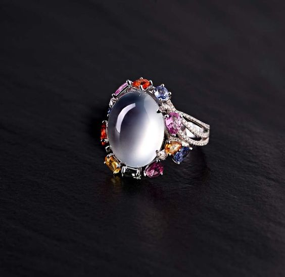 Zhaoyi is renowned for its use of colourless jade in its jewellery designs, such as this icy jadeite ring with diamonds and coloured gemstones.