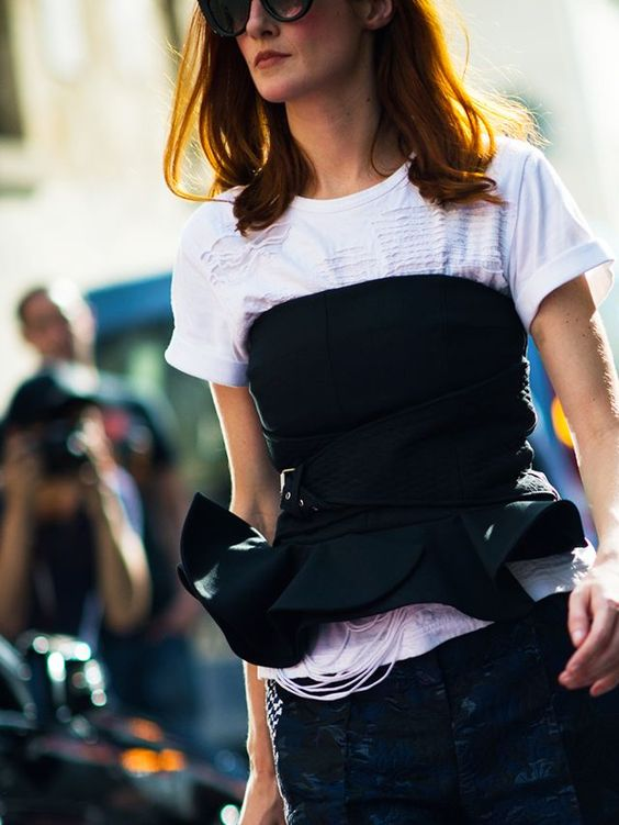 How to Wear the Tracksuit and Corset Trend: Taylor Tomasi-Hill wearing a bustier and T-shirt