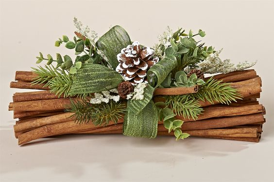 "12"" Natural Cinnamon Bundle with Faux Greens, Wintergreen Bow and White Tipped Pinecone:"