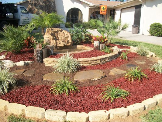 Southern cypress rubber mulch in a tiered landscape design for Tiered garden designs