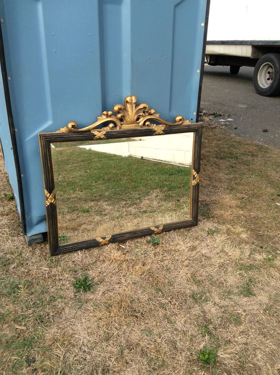 "Large gold and wood mirror. 40"" length. 3' height"