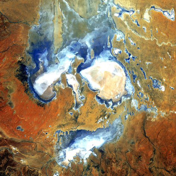 """The scary face in this image is actually inundated patches of shallow Lake Eyre (pronounced """"air"""") in the desert country of northern South Australia. An ephemeral feature of this flat, parched landscape, Lake Eyre is Australia's largest lake when it's full. However in the last 150 years, it has filled completely only three times."""