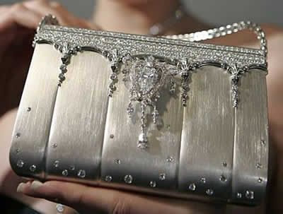 World's Most Expensive Purse  1.63 Million. The handbag is shaped out of pure platinum and studded with 2,182 diamonds totaling 208 carats.