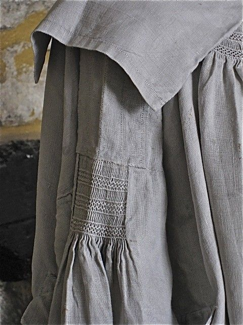 Detail of Antique Early 1800s Shepherds/Farm Workers Smock.  Check out the smocked details on the yoke area and sleeves.  On eBay, UK, at baraud.: