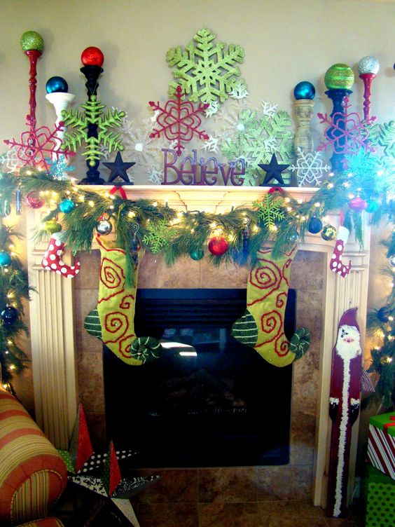 Festive Christmas mantel.  It is a little crazy but I am digging the snowflakes in different colors.