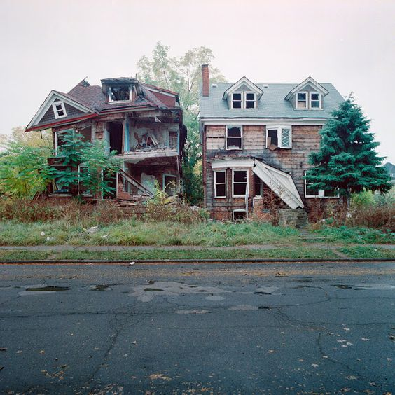 "Abandoned houses in Detroit.  This photo is a part of an ongoing series coined ""100 Abandoned Houses"" by photographer Kevin Bauman."