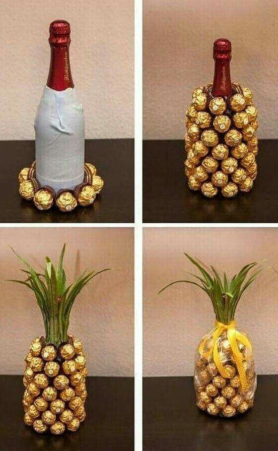 """Pineapple"" hostess gift made with wine bottle covered in individually wrapped gold foil chocolates"