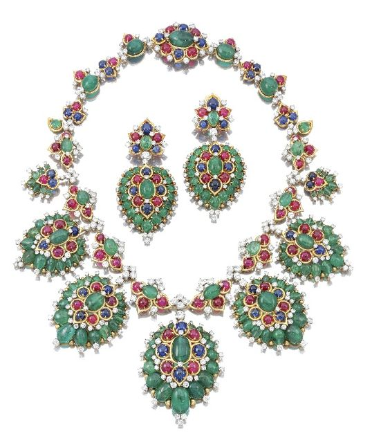 The demi-parure above is probably one of the finest examples of Bvlgari's exuberant use of coloured gemstones in extravagant designs which has set the House apart becoming its distinct trademark. It was made in 1968 and it is set with emerald beads and cabochon sapphires, rubies and emeralds in five large clusters. The light is brought in by a number of brilliant cut diamonds cleverly spread around the design.