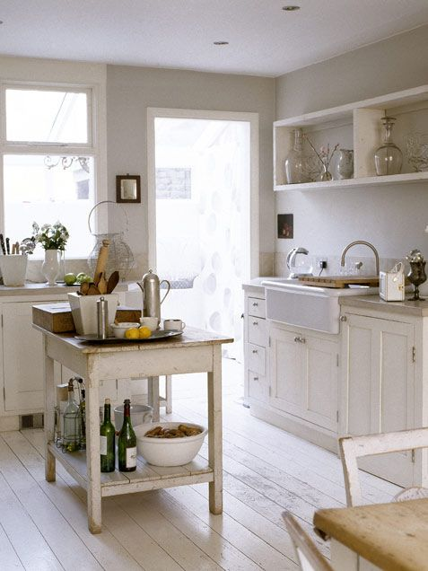 Summer Decor: Weathered White - neutral palette won't fall flat w/ mix of white wood surfaces, cream-colored ceramics & glass canisters. Similar island: Boos Gathering Island, $1,295 at Williams-Sonoma. Italian whiteware large deep serving bowl, $30 at Sur La Table.
