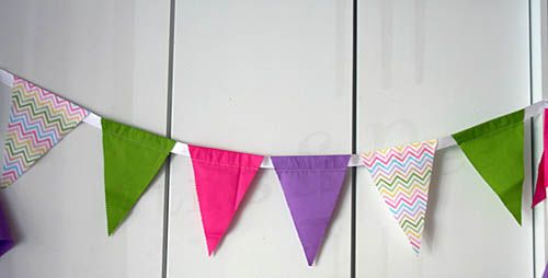 #DIY Pennant Banner - Find cute red or pink patterned fabric for a #ValentinesDay themed pennant! #partydecor