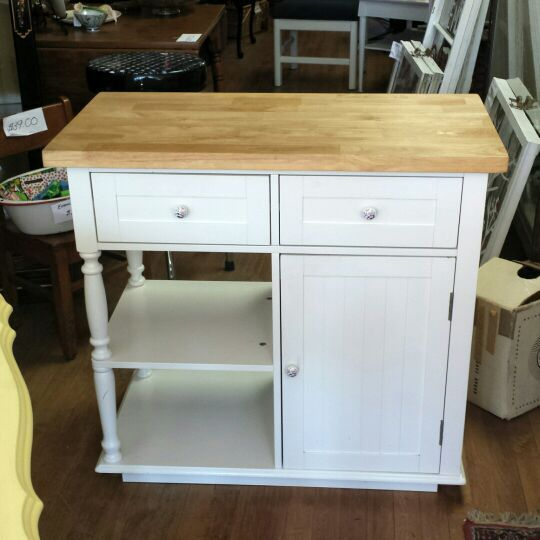 Used (normal wear) - Beautiful painted kitchen island storage cabinet. White with butcher block top. 2 years old. One owner. Excellent condition. Perfect for a small kitchen for a microwave or as a coffee/tea station.