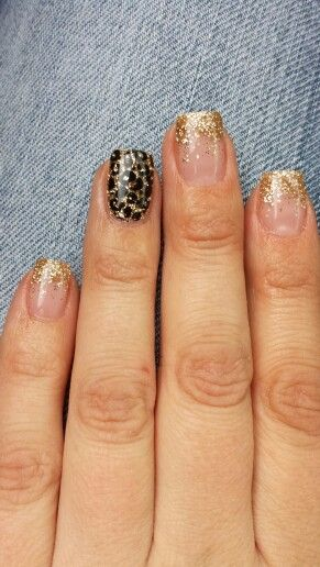 Gold gel nails with cheetah print accent
