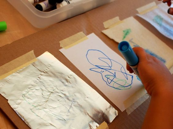 allow your child to draw on all the materials, talk about what's easy and difficult to draw on, what smears, etc